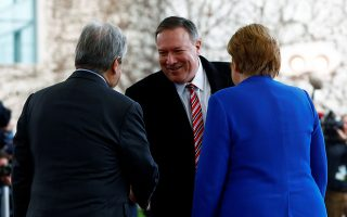 German Chancellor Angela Merkel and United Nations Secretary-General Antonio Guterres welcome U.S. Secretary of State Mike Pompeo at the Libya summit in Berlin, Germany, January 19, 2020.  REUTERS/Michele Tantussi