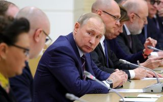 Russian President Vladimir Putin attends a meeting on drafting constitutional changes at the Novo-Ogaryovo residence outside Moscow, Russia, Thursday, Jan. 16, 2020. Putin proposed a set of constitutional amendments that could keep him in power well past the end of his term in 2024.(Mikhail Klimentyev, Sputnik, Kremlin Pool Photo via AP)