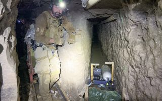 epa08177583 A handout photo made available by the US Customs and Border Protection (CBP) shows a tunnel entry team agent standing by for security at a tunnel spur that went off into a different direction, inside the 'Baja Metro Tunnel', in Otay Mesa, San Diego, California, USA, 13 November 2019 (issued 30 January 2020). The CBP announced on 29 January 2020 that authorities discovered in late August 2019 the 'longest illicit cross-border tunnel along the Southwest border'. The tunnel, stretching for around 1,313 meters and reportedly used for cross-border smuggling, originates in an industrial area in Tijuana, Baja California, Mexico and connected to the San Diego area in California. No arrests or seizures have been made since the discovery of the tunnel, CBP added.  EPA/US CUSTOMS AND BORDER PROTECTION HANDOUT  HANDOUT EDITORIAL USE ONLY/NO SALES
