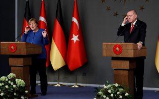 Turkish President Tayyip Erdogan and German Chancellor Angela Merkel attend a joint news conference in Istanbul, Turkey, January 24, 2020. REUTERS/Umit Bektas