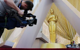 A cameraman films an Oscar statue on the red carpet as Oscars preparations continue for the 92nd Academy Awards in Hollywood, Los Angeles, California, U.S, February 7, 2020.     REUTERS/Eric Gaillard