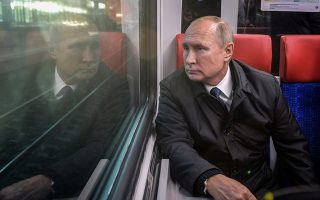 FILE PHOTO: Russian President Vladimir Putin rides from Belorusskaya to Fili station on the Russian-made Ivolga train during the launch of the first routes of the Moscow Central Diameters, the new surface metro lines./File Photo