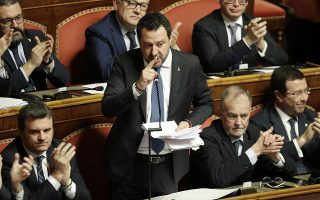 Opposition populist leader Matteo Salvini speaks at the end of the debate at the Italian Senate on whether to allow him to be prosecuted – as he demands to be -- for alleging holding migrants hostage for days aboard coast guard ship Gregoretti instead of letting them immediately disembark in Sicily, while he was interior minister, in Rome, Wednesday, Feb. 12, 2020. Salvini says being on trial for alleged kidnapping is tantamount to defending his country from illegal migrants he blames for crime and for subtracting jobs from Italians. (AP Photo/Andrew Medichini)