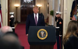 President Donald Trump arrives to speak in the East Room of the White House, Thursday, Feb. 6, 2020, in Washington. . (AP Photo/ Evan Vucci)