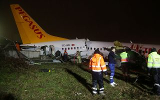 First responders and paramedics work at the site of the Pegasus Airlines plane that overran the runway and crashed, at Istanbul's Sabiha Gokcen airport, Turkey February 5, 2020. REUTERS/Cansu Alkaya