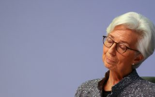 FILE PHOTO: European Central Bank (ECB) President Christine Lagarde reacts as she addresses a news conference on the outcome of the meeting of the Governing Council, in Frankfurt, Germany, March 12, 2020. REUTERS/Kai Pfaffenbach -/File Photo