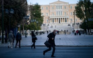 A man, wearing a protective face mask, crosses the street, as the Greek government implemented strict precautionary measures against the spread of the coronavirus disease (COVID-19), in Athens, Greece, March 16, 2020. REUTERS/Alkis Konstantinidis