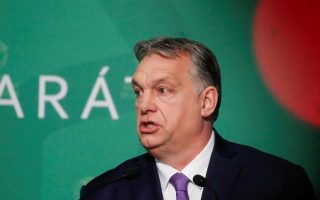 FILE PHOTO: Hungarian Prime Minister Viktor Orban speaks during a business conference in Budapest, Hungary, March 10, 2020. REUTERS/Bernadett Szabo/File Photo