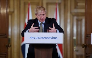 Britain's Prime Minister Boris Johnson attends a news conference on the ongoing situation with the coronavirus disease (COVID-19) in London, Britain March 18, 2020. Eddie Mulholland/Pool via REUTERS