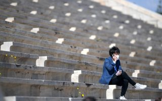 Olympics - Olympic Flame Handover Ceremony - Panathenaic Stadium, Athens, Greece - March 19, 2020  A man wearing a protective face mask during the olympic flame handover ceremony for the 2020 Tokyo Summer Olympics. The ceremony is being held behind closed doors as the spread of the coronavirus disease (COVID-19) continues  Aris Messinis/Pool via REUTERS
