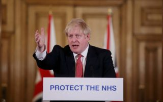 Prime Minister Boris Johnson speaks during a news conference on the ongoing situation with the coronavirus disease (COVID-19) in London, Britain March 22, 2020.  Ian Vogler/Pool via REUTERS