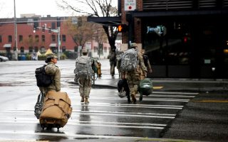 Soldiers from the 627th Army Hospital from Fort Carson, Colorado walk across the street after working at CenturyLink Field Event Center, which is being turned into a military field hospital for non coronavirus patients during the coronavirus disease (COVID-19) outbreak in Seattle, Washington, U.S. March 30, 2020.  REUTERS/Lindsey Wasson