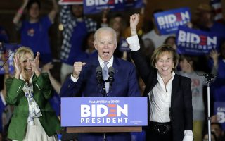 Democratic presidential candidate former Vice President Joe Biden speaks at a primary election night campaign rally Tuesday, March 3, 2020, in Los Angeles with his wife Jill Biden, left, and his sister Valerie. (AP Photo/Chris Carlson)