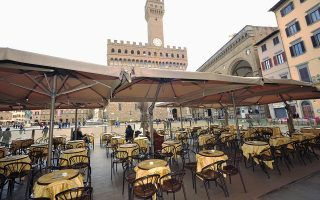 Empty tables are pictured outside a restaurant at Palazzo Vecchio as Italy battles a coronavirus outbreak, in Florence, Italy, March 7, 2020. REUTERS/Jennifer Lorenzini