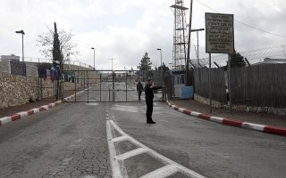 Israeli policeman stand in front of a closed crossing between Jerusalem and Bethlehem, Friday, March 6, 2020. The closure that started Friday followed the identification of seven cases of COVID-19 among Palestinians in the city, the first in the Palestinian territories. Israel also announced a closure on Bethlehem affecting Israelis, Palestinians and tourists. (AP Photo/Mahmoud Illean)