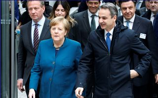 German Chancellor Angela Merkel and Greece Prime Minister Kyriakos Mitsotakis arrive to a German-Greek business forum in Berlin, Germany March 9, 2020.    REUTERS/Michele Tantussi