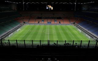FILE PHOTO: Soccer Football - Europa League - Round of 32 Second Leg - Inter Milan v Ludogorets - San Siro, Milan, Italy - February 27, 2020    General view of an empty stadium before the match after fans were not allowed in over coronavirus fears  Emilio Andreoli/Pool via Reuters/File Photo