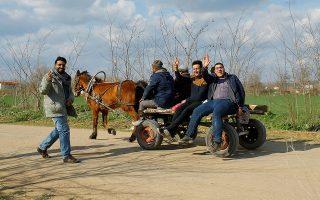 Migrants travel on a horse carriage near the Turkey's Pazarkule border crossing with Greece's Kastanies, near Edirne, Turkey March 6, 2020. REUTERS/Huseyin Aldemir