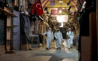 FILE PHOTO: Workers in protective suits spray disinfectant at Grand Bazaar, known as the Covered Bazaar, to prevent the spread of coronavirus disease (COVID-19), in Istanbul, Turkey, March 25, 2020. REUTERS/Umit Bektas/File Photo