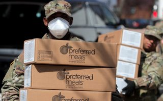 U.S. Army National Guard personnel unload boxes of preferred meals to distribute free to residents in the East Harlem section of Manhattan during the outbreak of the coronavirus disease (COVID-19) in New York City, New York, U.S., April 1, 2020. REUTERS/Brendan Mcdermid
