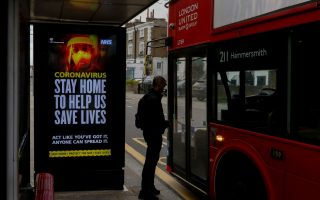 A UK government warning is seen at a bus stop as the spread of the coronavirus disease (COVID-19) continues in London, Britain, April 2, 2020.  REUTERS/Kevin Coombs