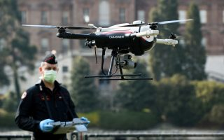 A Carabinieri operates a drone near the banks of Po river and Valentino park, for checking the compliance of the measures imposed by the government as the coronavirus outbreak continues to grow in Turin, Italy, April 3, 2020. REUTERS/Massimo Pinca