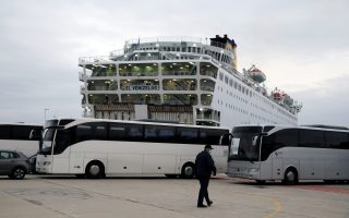 The Eleftherios Venizelos passenger ship is moored at the dock of Piraeus after some passengers tested positive for the novel coronavirus and authorities placed the ship under quarantine, following the outbreak of the coronavirus disease (COVID-19), in Piraeus, Greece, April 3, 2020. REUTERS/Costas Baltas