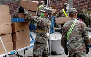 U.S. Army National Guard personnel stack boxes of free food provided by multiple New York City agencies for distribution to local residents in the Harlem neighbourhood of Manhattan during the outbreak of the coronavirus disease (COVID19) in New York City, New York, U.S., April 8, 2020. REUTERS/Mike Segar