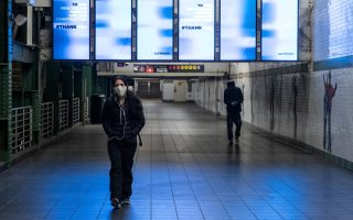 A woman wearing a face mask is seen in the Times Square subway station during the outbreak of the coronavirus disease (COVID-19) in New York City, U.S., April 17, 2020. REUTERS/Jeenah Moon