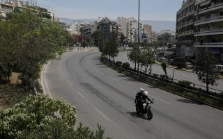 Police officers ride a motorcycle on an empty avenue on Easter Sunday, during a nationwide lockdown to prevent the spread of the coronavirus disease (COVID-19) outbreak in Athens, Greece, April 19, 2020. REUTERS/Costas Baltas