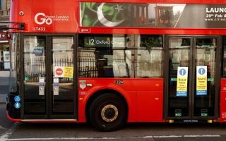 Notices are seen on a London bus indicating to board at the middle doors, as the spread of the coronavirus disease (COVID-19) continues, London, Britain, April 19, 2020. REUTERS/John Sibley