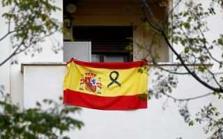 A Spanish flag hangs from a balcony during the lockdown following the coronavirus disease (COVID-19) outbreak in Ronda, southern Spain, April 19, 2020. REUTERS/Jon Nazca