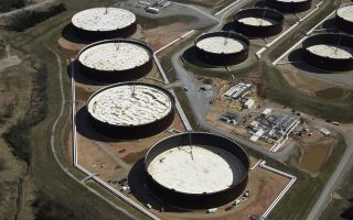 FILE PHOTO: Crude oil storage tanks seen from above at the Cushing oil hub in Cushing, Oklahoma, March 24, 2016. REUTERS/Nick Oxford/File Photo