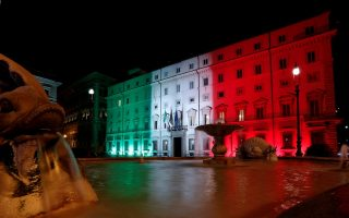 The Chigi Palace is lit up with the colours of the Italian flag, amid the spread of the coronavirus disease (COVID-19) in Rome, Italy April 21, 2020. REUTERS/Remo Casilli
