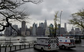 FILE PHOTO: Ambulances park toward the Manhattan skyline during the outbreak of the coronavirus disease (COVID-19) in the Brooklyn borough of New York City, U.S., April 24, 2020. REUTERS/Andrew Kelly/File Photo