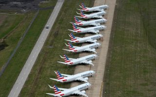 FILE PHOTO: American Airlines 737 max passenger planes are parked on the tarmac at Tulsa International Airport in Tulsa, Oklahoma, U.S. March 23, 2020. REUTERS/Nick Oxford/File Photo