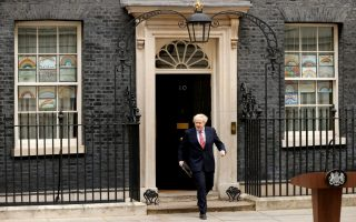 Britain's Prime Minister Boris Johnson before making a statement outside 10 Downing Street, after recovering from the coronavirus disease (COVID-19), London, Britain, April 27, 2020. REUTERS/John Sibley