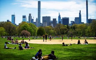 People rest and enjoy the day at Central Park maintaining social distancing norms, during the outbreak of the coronavirus disease (COVID-19) in the Manhattan borough of New York City, U.S., May 2, 2020. REUTERS/Eduardo Munoz