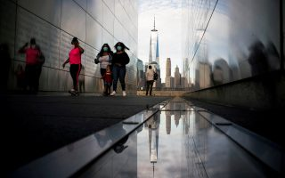 People visit the Empty Sky Memorial as the The One World Trade Center in New York is seen from Liberty State Park after many New Jersey Parks set to re-open during the outbreak of the coronavirus disease (COVID-19) in Jersey City, New Jersey, U.S., May 2, 2020. REUTERS/Eduardo Munoz     TPX IMAGES OF THE DAY