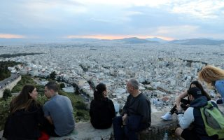 People sit overlooking Athens following the coronavirus disease (COVID-19) outbreak, Greece, May 3, 2020. REUTERS/Goran Tomasevic