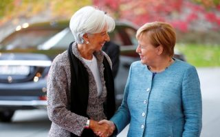 FILE PHOTO: German Chancellor Angela Merkel welcomes then-International Monetary Fund Managing Director Christine Lagarde ahead of the 'G20 Compact with Africa' summit at the Chancellery in Berlin, Germany, October 30, 2018. REUTERS/Hannibal Hanschke/File Photo