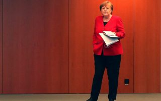 German Chancellor Angela Merkel waits for the beginning of a news conference after an online meeting with German state governors on the loosening of the restrictions to reduce the spread of the coronavirus disease (COVID-19), in Berlin, Germany May 6, 2020. Michael Sohn/Pool via REUTERS