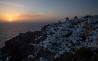 A view of Oia as the sun sets, following the coronavirus disease (COVID-19) outbreak, on the island of Santorini, Greece, May 6, 2020. Picture taken May 6, 2020. REUTERS/Alkis Konstantinidis