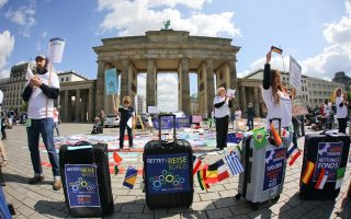 Members of travel agencies and the tourism industry participate in a demonstration demanding financial help from the government, amid the spread of the coronavirus disease (COVID-19) in Berlin, Germany, May 13, 2020. REUTERS/Hannibal Hanschke