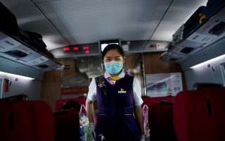 A train staff member walks on a high-speed train at Wuhan Railway Station, in Wuhan, the Chinese city hit the hardest by the coronavirus disease (COVID-19) outbreak, in the Hubei province, China, May 17, 2020. REUTERS/Aly Song