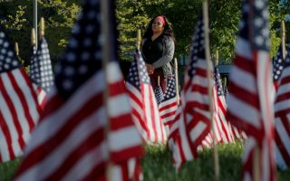 U.S. flags are planted amid the coronavirus disease (COVID-19) outbreak and ahead of the Memorial Day holiday in the U.S. at the Massachusetts Fallen Hero Memorial in Boston, Massachusetts, U.S., May 20, 2020.   REUTERS/Brian Snyder
