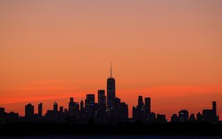 One World Trade Center and the lower Manhattan skyline are seen shortly after sunset, during the outbreak of the coronavirus disease (COVID-19) from the Rockaway section of Queens in New York City, U.S., May 20, 2020. REUTERS/Brendan McDermid