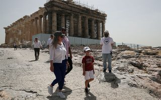 Visitors walk past the Parthenon temple as the Acropolis archaeological site opens to visitors, following the easing of measures against the spread of the coronavirus disease (COVID-19, in Athens, Greece, May 18, 2020. REUTERS/Alkis Konstantinidis
