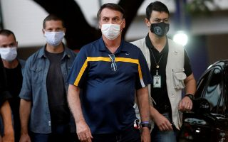 Brazil's President Jair Bolsonaro is seen after meeting Brazil's Minister of the Secretariat of Government Luiz Eduardo Ramos in his home  amid the coronavirus disease (COVID-19) outbreak, in Brasilia, Brazil, May 23 2020. REUTERS/Adriano Machado