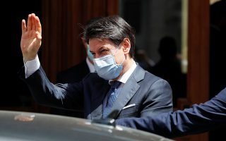 Italian Prime Minister Giuseppe Conte wearing a protective face mask leaves the Senate, as the spread of the coronavirus disease (COVID-19) continues, in Rome, Italy May 20, 2020. REUTERS/Remo Casilli